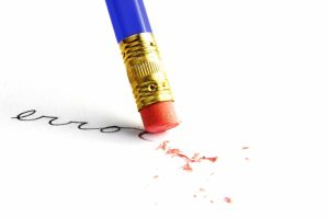 "Pencil erasing an ""error"", on white"