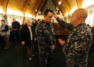 Sailors observe Ash Wednesday.