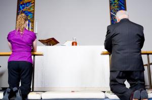 Senior Caucasian Man Young Woman Kneeling Communion Rail in Chur
