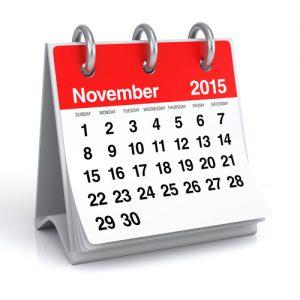 Red Office Desktop 2015 Spiral Calendar. Isolated on White Background. 3D Rendering